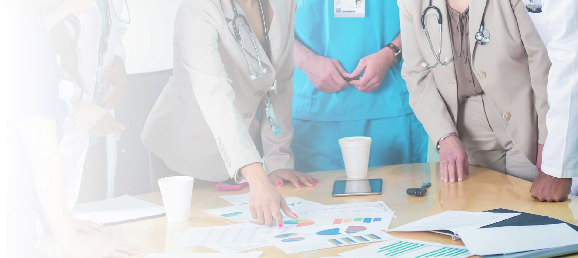 medical personnel looking at charts