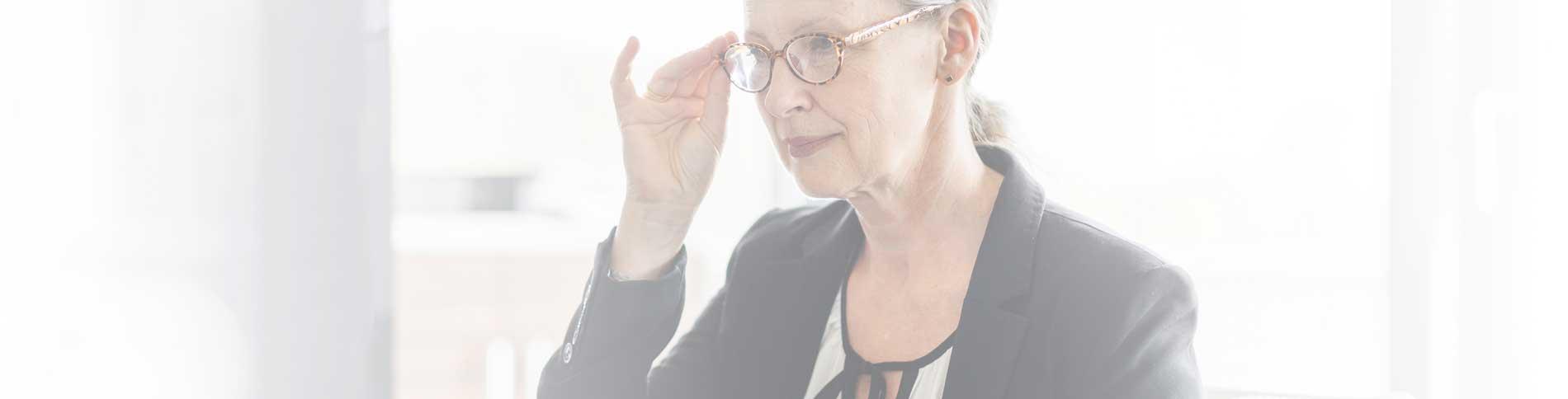 woman adjusting her glasses